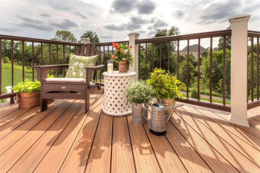 TRANSCEND® RAILING IN CLASSIC WHITE AND VINTAGE LANTERN WITH BRONZE ROUND BALUSTERS AND DECKING IN TIKI TORCH AND VINTAGE LANTERN