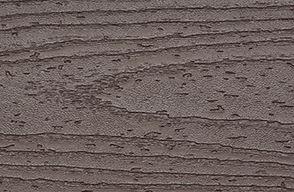 Un échantillon de couleur de lame de plancher composite Trex Transcend brun foncé Vintage Lantern