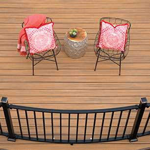 Trex composite decking with a black railing and pink lawn chairs
